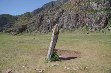 Chui Deer stone of ancient sanctuary of Adyr-Kan. Ancient megalith with carved human face. Nature and travel. Russia, Altai Republic, Ongudaysky District