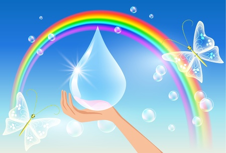 The hand holds a sparkling drop against a rainbow. Symbol of clean water.