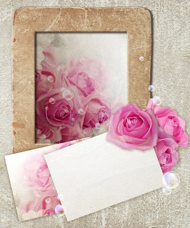 Old grunge photo frame with roses and paper for letter Stock Photo - 12468180