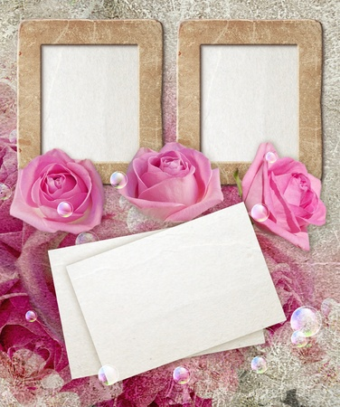 Old grunge photo frame with roses and paper for letter   photo
