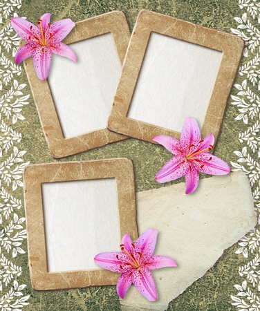 Old grunge photo frame with lily and paper for text   photo