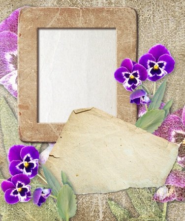 Old grunge photo frame with pansy and paper for letter Stock Photo - 12469472