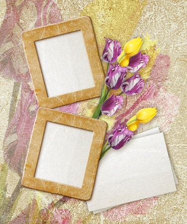Old grunge photo frame with tulips and paper for letter photo