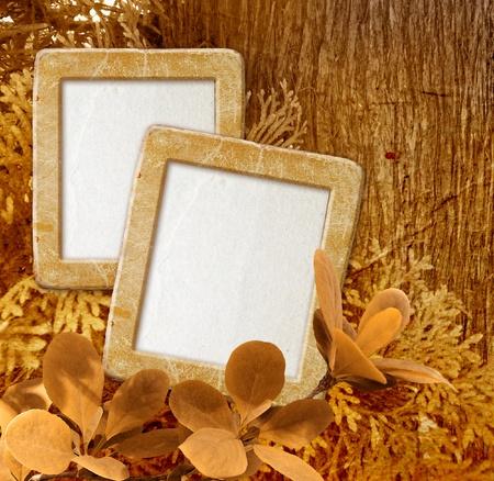 album greetings: Old grunge photo frame against wood