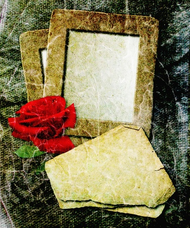 vintage photo frame: Old grunge photo frame with red rose and paper for letter   Stock Photo