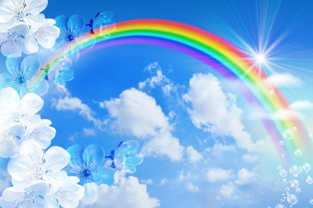 heaven background: White flowers and rainbow against the sky Stock Photo