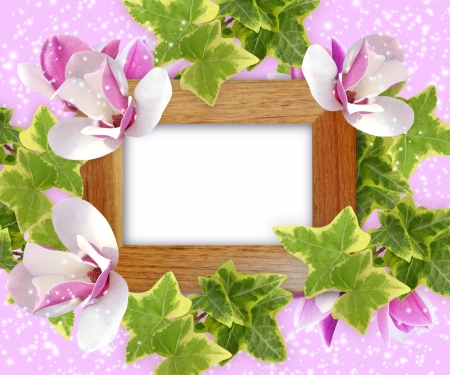 Magnolia and wooden photo frame photo