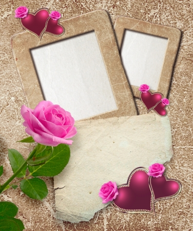 Old grunge photo frame with roses, hearts and paper for letter   photo