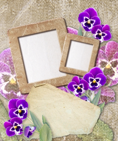 Old grunge photo frame with pansy and paper for letter Stock Photo - 17825857