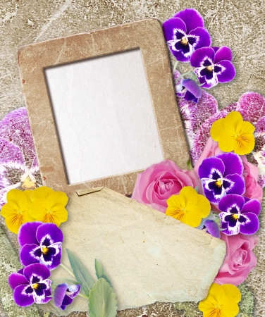 Old grunge photo frame with pansy and paper for letter   Stock Photo - 17825855