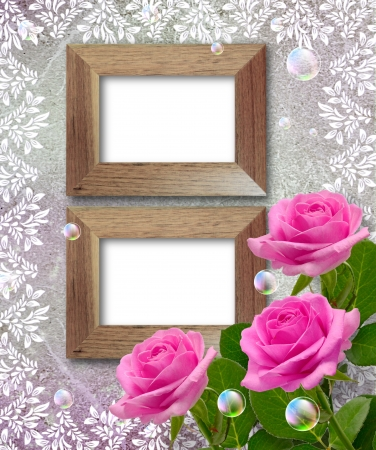 Old grunge background with roses and wooden frame photo