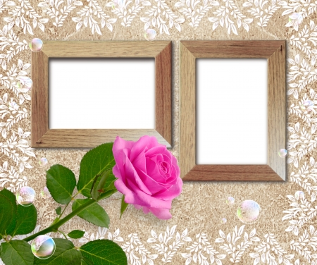 Old grunge background with rose and wooden frame photo