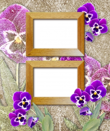Old grunge background with violet pansy and wooden photo frame photo