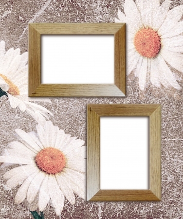 photo album: Old grunge background with daisies and wooden photo frame