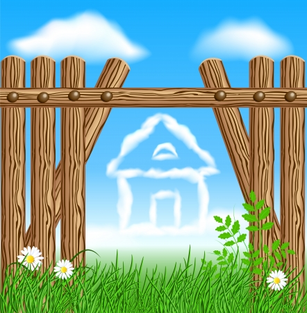 Wooden fence on green grass with daisy against the sky and clouds house