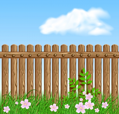 enclosures: Wooden fence on green grass with flowers against the sky