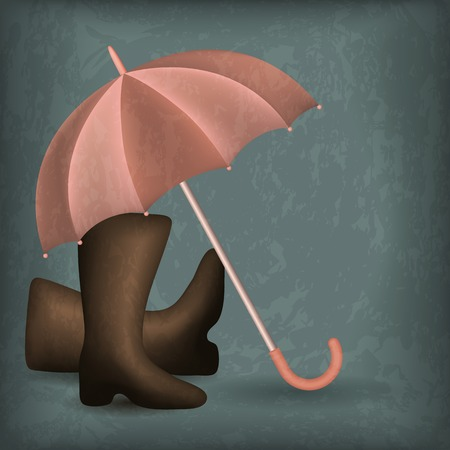 wellingtons: Opened rain umbrella and rubber boots on the shabby background