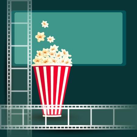 cinematograph: El paquete con palomitas de ma�z en oscura sala de cine con pantalla luminosa y tira de pel�cula