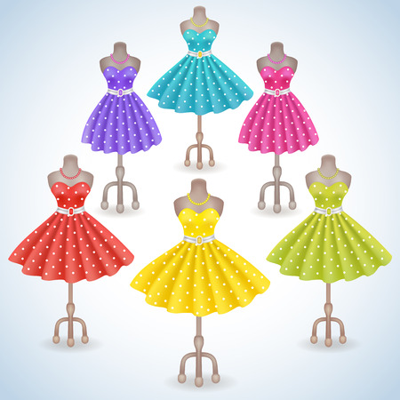 folds: Collection fashionable dress with polka dots in retro style on dummy in shop or salon store