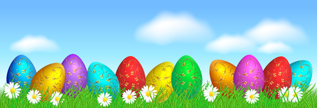 Easter eggs with decorative golden ornament on green grass against blue sky and clouds