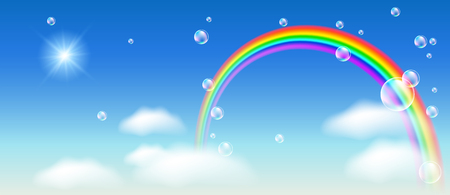 Rainbow with clouds in the blue sky and bubbles