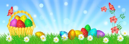 Easter eggs with decorative golden ornament on green grass and basket against blue sky with sun rays