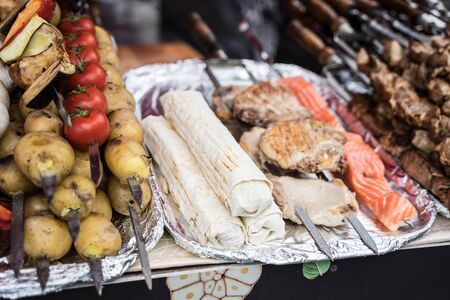 kebabs of meat, mushrooms, fish and vegetables Stock Photo