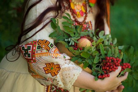 Russian-folk style girl: costume, kokoshnik with rowan and apples Stok Fotoğraf