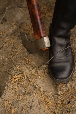 black boot and brown ax