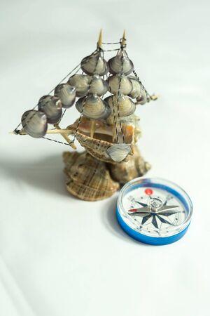colorful seashell boat and plastic compass Archivio Fotografico
