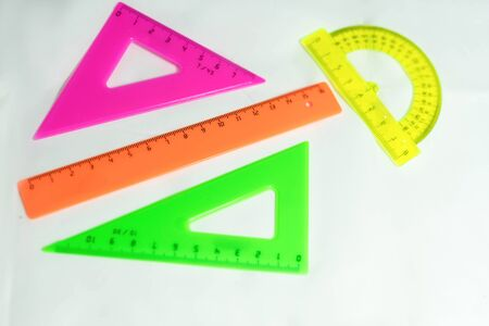 multi-colored rulers for mathematics on a white background Stockfoto