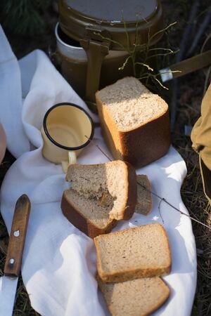 iron military mug, bread lie on a white towel