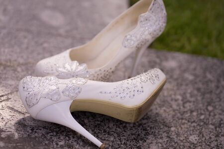 white high-heeled women shoes with patterns