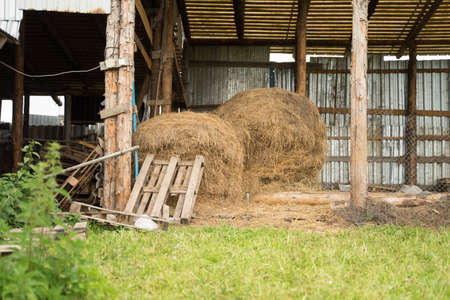 large wooden shed with hay