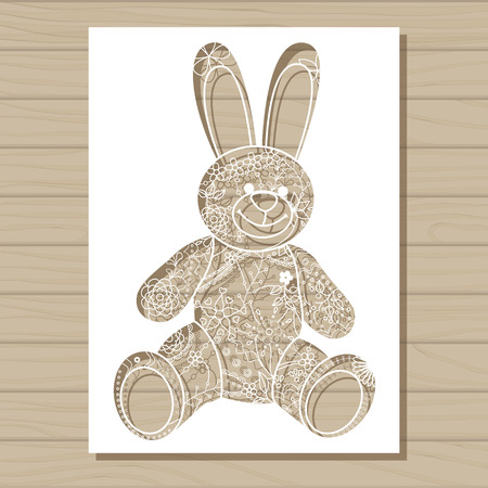 stuff toy: Vector stencil template of bunny on wooden background