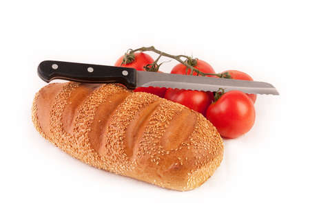 Bread, knife and bunch of tomatoes photo