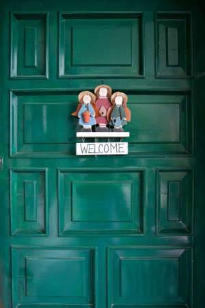 Welcome sign hanging at green doors. Stock Photo - 4776680