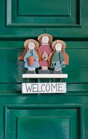 Welcome sign hanging at green doors. Stock Photo - 4776674