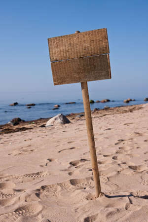 One blank wooden sign at empty beach. Stock Photo - 4935566