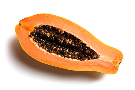 Papaya fruit (Paw Paw) cut in half on a plain white background from above
