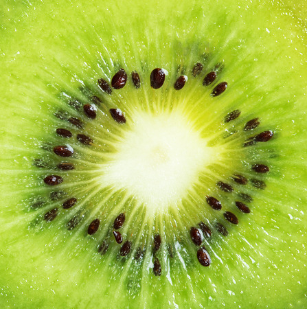 Fresh Kiwi Fruit sliced and photographed close-up and full frame