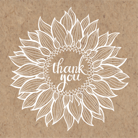 Thanksgiving card with sunflower and lettering on kraft paper.