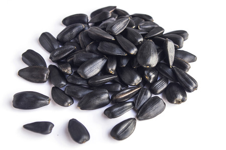 sunflower seeds: sunflower seeds on a white background Stock Photo