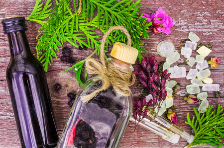 glass bottles: Herbals and oil in glass bottles on wooden background