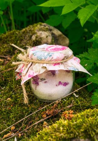 glass jar: Candied lilac flowers in a glass jar