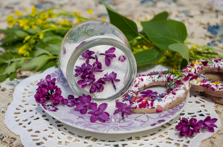 candied: Candied lilac flowers in a glass jar and cookies