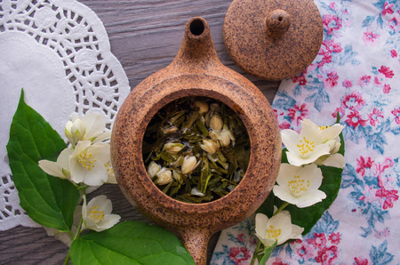 chinese teapot: Jasmine tea in a clay Chinese teapot Stock Photo