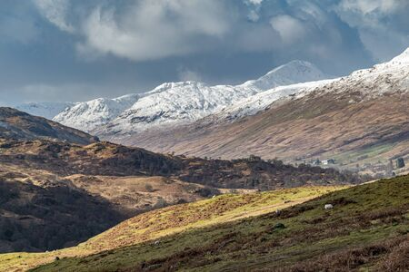 First snow in Scottish Highlands, view from the slopes of Meall Ghaordaidh, Glen Lochay. Scottish Highlands dramatic winter Landscape. Stock Photo