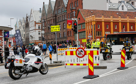 a white police motorcycle: BERGEN  NORWAY June 25, 2016. Norway crown family visit to Bergen. Security. Editorial