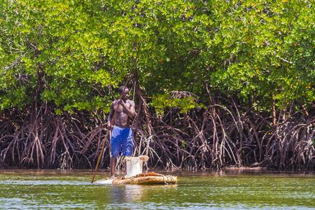 indian creek: Boat left on shore after tide. Watamu, Kenya Editorial